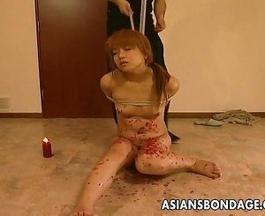 Hanging on a swing Asian babe gets waxed