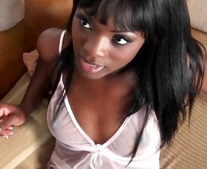Stunning black female with gorgeous eyes flirts