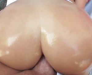 Oiled-up booty blonde enjoys hardcore fucking with a big-dicked dude