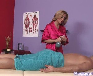 Robe-wearing blonde masseuse gets handsy with a client